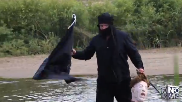 MAN CROSSES U.S. BORDER DRESSED AS ISIS TERRORIST, SIMULATES BEHEADING