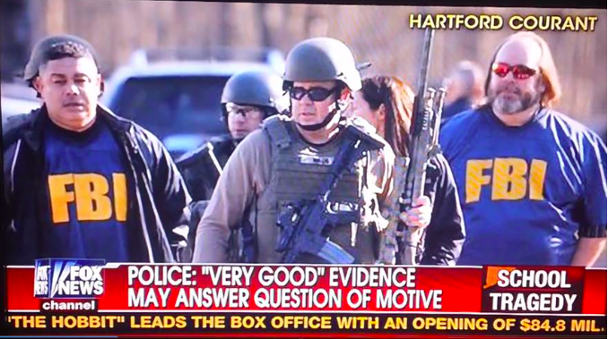 "Ed Henry (FOX) reports from the White House, while (known actor) David Wheeler strolls around Newtown in ""SWAT"" costume:"